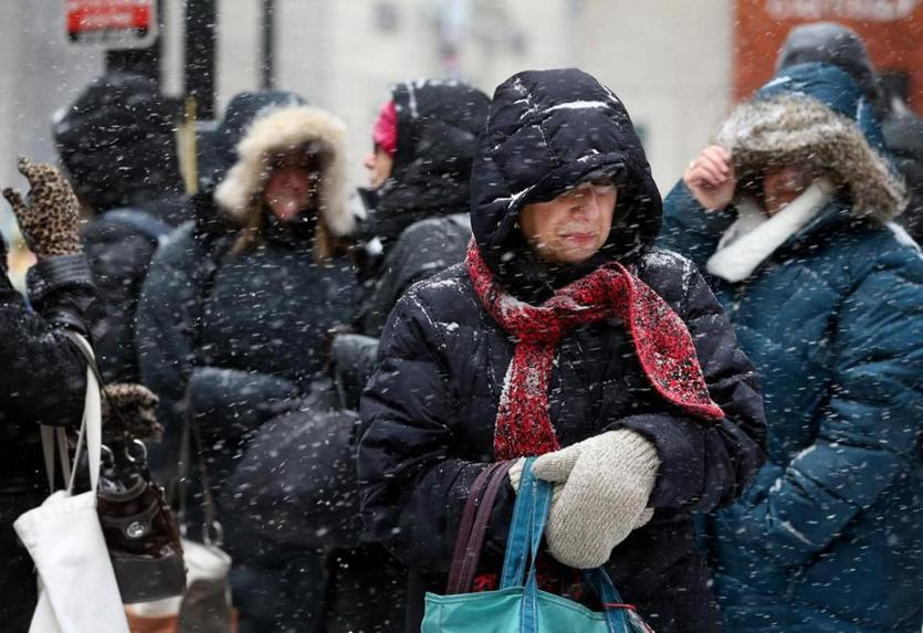 Dolores Callahan waited for her bus on State Street during Tuesday's snowstorm.